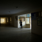 November 11, 2012 - Kabul, Afghanistan: A sixth grade female student monitors the corridors at Shirino High School in Kabul...After decades without access to education under the Taliban regime, and despite the still existent social stigmas, female students make now 40 per cent of the over all students in the country. (Paulo Nunes dos Santos)