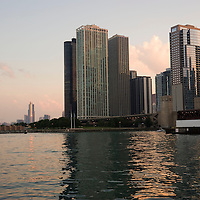 Chicago harbor and skyline at sunset, Illinois, USA
