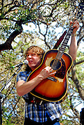 Ben Kweller performing in Zilker Park for the Barton Springs Greenbelt Clean-up, Austin Texas, November 1, 2008. The greenbelt clean-up was sponsored by ClifBar, Green Notes, Austin Parks Foundation, REI, Keep Austin Beautiful and the Austin Chapter of the Sierra Club. Ben Kweller (born 1981) is an American rock musician.