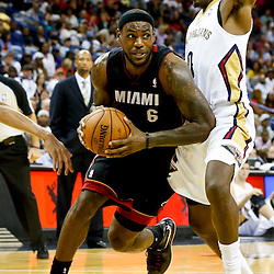 Oct 23, 2013; New Orleans, LA, USA; Miami Heat small forward LeBron James (6) drives past New Orleans Pelicans small forward Al-Farouq Aminu (0) during the second half of a preseason game at New Orleans Arena. The Heat defeated the Pelicans 108-95. Mandatory Credit: Derick E. Hingle-USA TODAY Sports