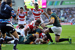 Michael Leitch of Japan scores a try in the first half - Mandatory byline: Patrick Khachfe/JMP - 07966 386802 - 19/09/2015 - RUGBY UNION - Brighton Community Stadium - Brighton, England - South Africa v Japan - Rugby World Cup 2015 Pool B.