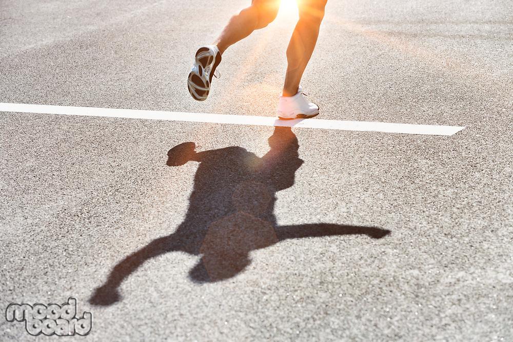Man running on white starting line