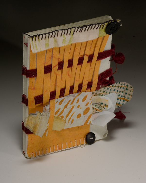 Artist: Kathyrn Petke. Book sewn of tapes with decorated paper cover.