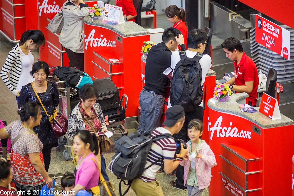 01 OCTOBER 2012 - BANGKOK, THAILAND:  The Air Asia counter in Don Mueang International Airport in Bangkok Monday. Don Mueang International Airport is the smaller of two international airports serving Bangkok, Thailand. Suvarnabhumi Airport, opened in 2006 is the main one. Don Mueang was officially opened as a Royal Thai Air Force base on 27 March 1914 and commercial flights began in 1924. Don Mueang Airport closed in 2006 following the opening of Bangkok's new Suvarnabhumi Airport, and reopened as a domestic terminal for low cost airlines after renovation on 24 March 2007. Closed during the flooding in 2011, Don Mueang was again renovated and reopened in 2012 as the airport for low cost airlines serving both domestic and international passengers. On Monday, Air Asia, Asia's leading low cost airline, transferred all of their flight operations to Don Mueang and the airport was officially reopened. Suvarnabhumi International Airport is already over capacity and Don Mueang's importance as a hub is expected to grow.   PHOTO BY JACK KURTZ