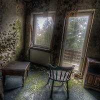 Old very moldy hotel.<br /> Hotel Schimmelig interior with chair