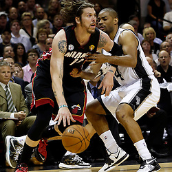 Jun 13, 2013; San Antonio, TX, USA; Miami Heat shooting guard Mike Miller (13) dribbles against San Antonio Spurs point guard Gary Neal (14) during the first quarter of game four of the 2013 NBA Finals at the AT&T Center. Mandatory Credit: Derick E. Hingle-USA TODAY Sports