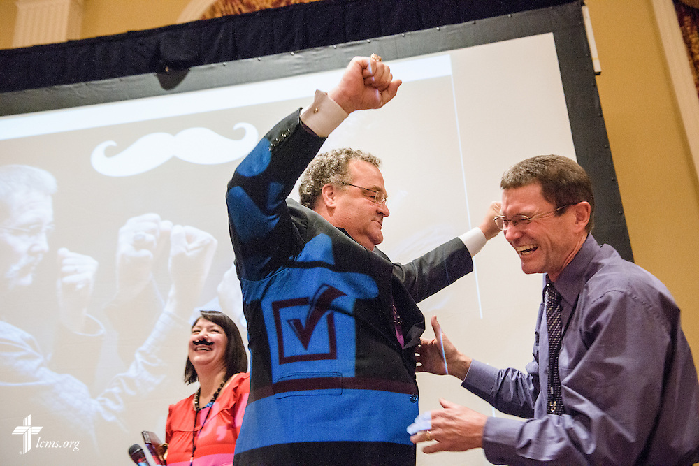 "The Rev. Terry R. Forke, president of Montana District, and the Rev. Dr. Matthew C. Harrison, president of The Lutheran Church–Missouri Synod, laugh together during ""the Great Mustache Shave Off"" at the Liberty National LCMS Campus Ministry Conference on Wednesday, Jan. 4, 2017, at the University of Maryland in College Park, Md. LCMS Communications/Erik M. Lunsford"