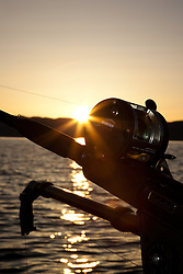 """Sunrise Fishing on Lake Tahoe 6"" - Photograph of a fishing reel at sunrise on Lake Tahoe. Shot during the 2012 Jake's on the Lake fishing derby."
