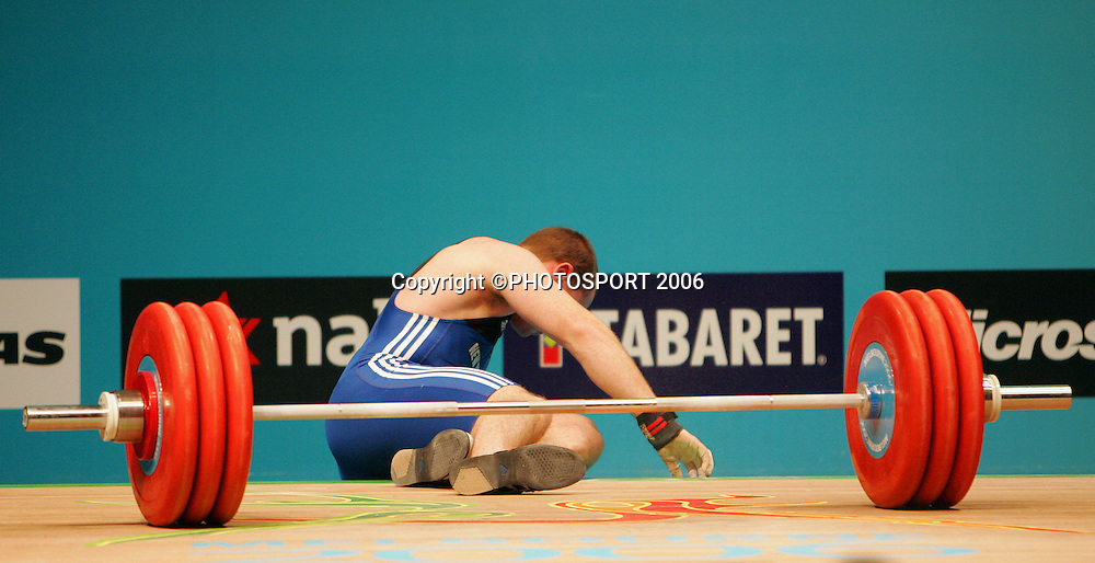 New Zealand's Grant Cavitt falls to the floor during the Mens 94kg Weightlifting on day 6 of the XVIII Commonwealth Games, Melbourne, Australia, Tuesday, March 21 2006. Photo: Michael Bradley/PHOTOSPORT<br /> <br /> 210306 151415