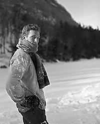 man standing in the snow near a mountain in Upstate New York