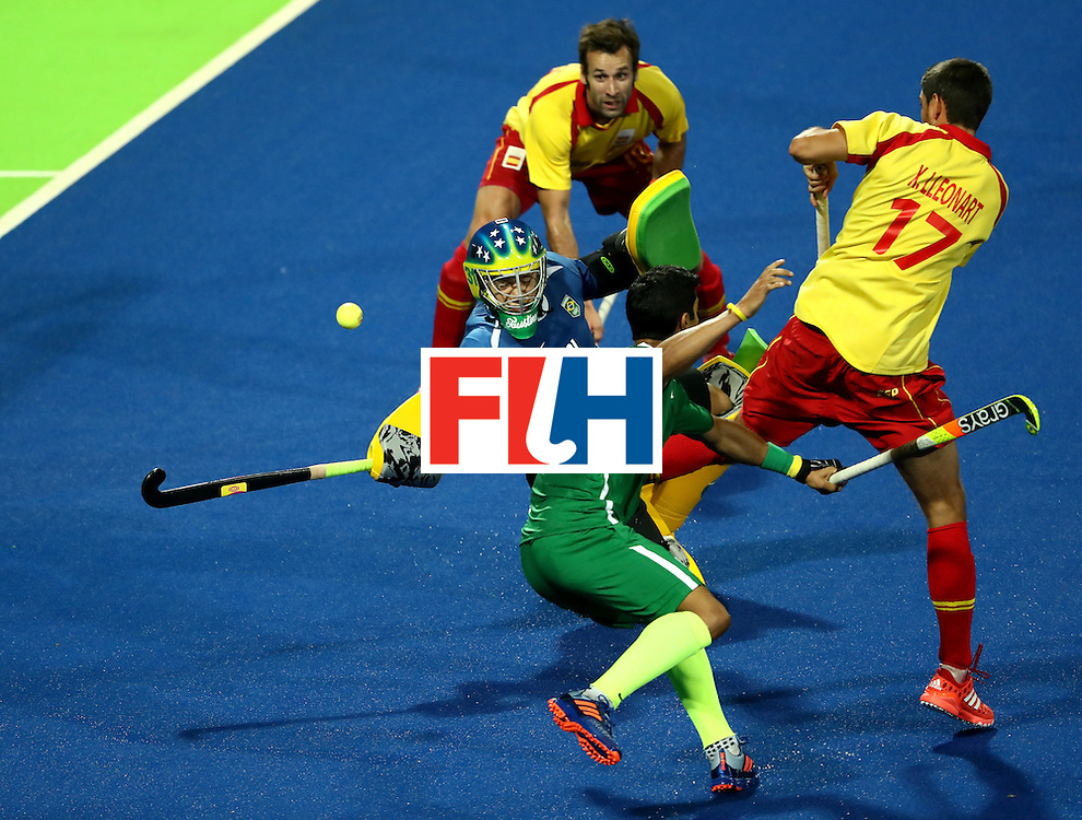 RIO DE JANEIRO, BRAZIL - AUGUST 06:  Rodrigo Faustino #31 of Brazil lunges for a shot by Xavi Lleonart #17 of Spain during a Men's Pool A match between Brazil and Spain on Day 1 of the Rio 2016 Olympic Games at the Olympic Hockey Centre on August 6, 2016 in Rio de Janeiro, Brazil.  (Photo by Sean M. Haffey/Getty Images)