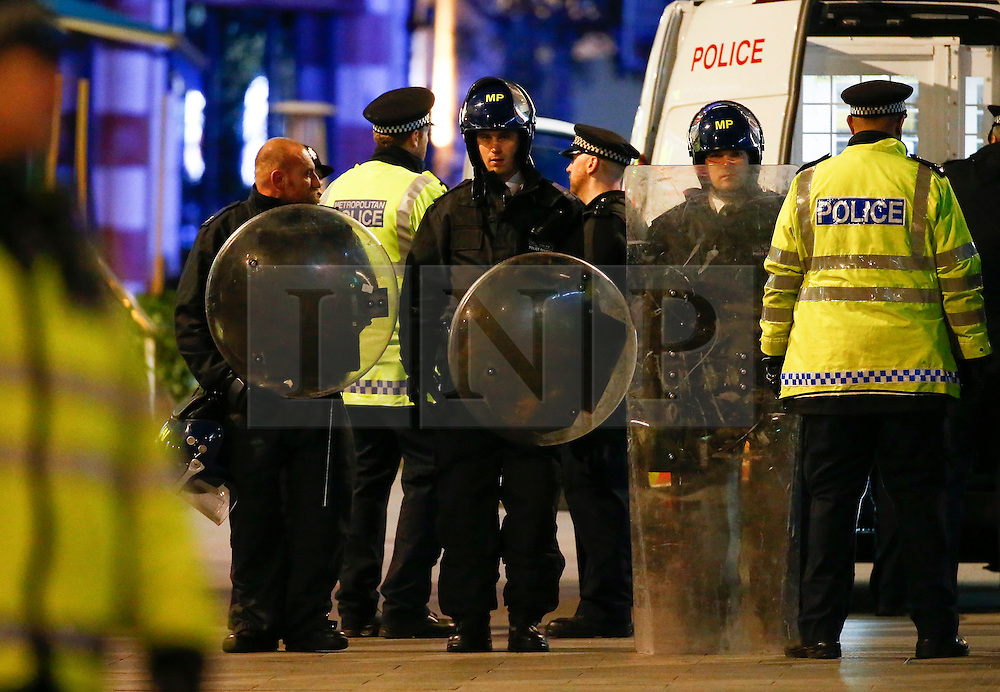 "© Licensed to London News Pictures. 24/02/2016. London, UK. Police in riot gear on scene of a ""hostage situation"" at Bella Italia restaurant in Leicester Square, London where a man claiming to be in possession of a knife is holding a woman against her will. Metropolitan Police reported the incident is not terrorist-related. Photo credit: Tolga Akmen/LNP"