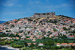 View of town of Molyvos or Mithymna with historic castle on hill on Lesvos Island in Greece