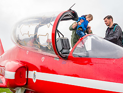 Pictured: Scotland's National Airshow, East Fortune, East Lothian, Scotland, United Kingdom, 27 July 2019 . A packed programme of aircraft old and new planned to take to the skies for the aerial display was marred by poor weather at airfields around the country which meant that many of the promised flights were unable to perform.  People are able to sit in a red arrow plane.<br /> Sally Anderson | EdinburghElitemedia.co.uk