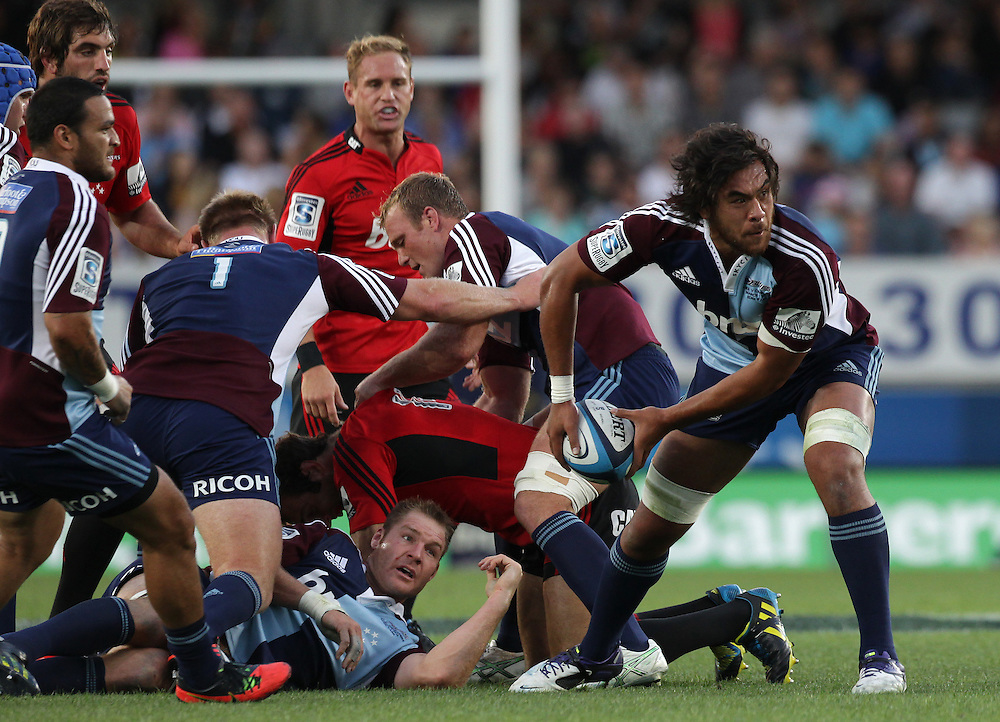 Blues' Steven Luatua clears the ball from captain Ali Williams whilst playing the Crusaders in a Super Rugby match, Eden Park, Auckland, New Zealand, Friday, March 01, 2013.  Credit:SNPA / David Rowland