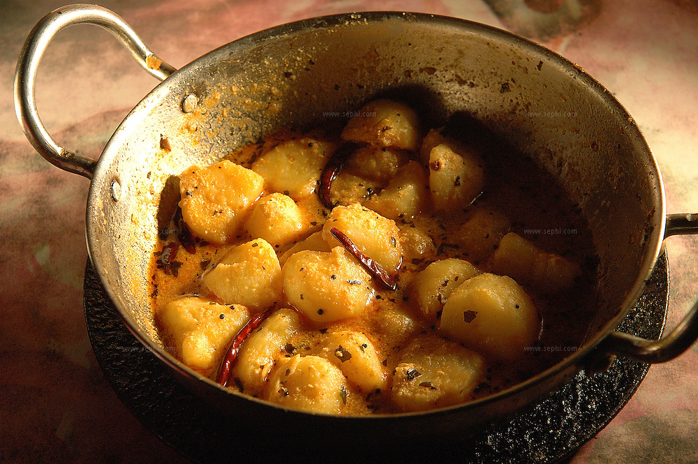 Aloo Dam - Potatoes cooked in yogurt ( Recipe available upon request )