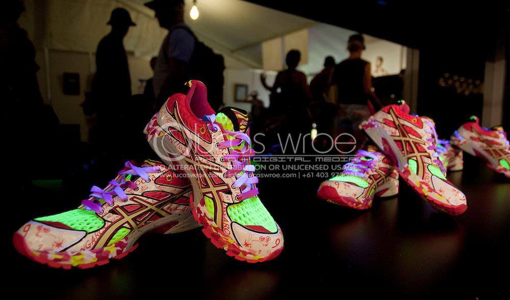 2010 Noosa Triathlon Festival.Noosa Triathlon Sport and Lifestyle Expo.Assics new special edition Noosa Triathlon shoes. Glow under black light..29/10/2010.Noosa Tri Sport & Lifestyle Expo, Noosa Woods, Noosa, Queensland, Australia.