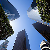 Upward view photo of Los Angeles city skyscraper office buildings in Southern California in the United States.