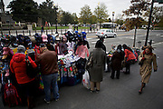 Tourists lookover memorabilia from a street vendor near the White House on Nov. 7, 2012 in Washington, D.C.