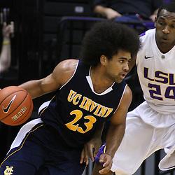 December 15, 2011; Baton Rouge, LA; UC Irvine Anteaters guard/forward Michael Wilder (23) drives past LSU Tigers forward Storm Warren (24) during the first half of a game at the Pete Maravich Assembly Center.  Mandatory Credit: Derick E. Hingle-US PRESSWIRE