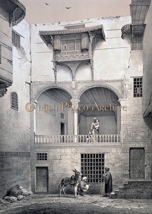 House called Beyt-el-Tcheleby, Cairo, Egypt: Facade overlooking the courtyard, XVIII th century. Lithograph from 'L'Art arabe d'apres les monuments du Caire' 1869-1877 by Emile Prisse d'Avennes, (1807-1879) French architect and engineer.