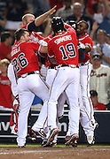 ATLANTA, GA - JUNE 08:  Left fielder Jason Heyward #22 of the Atlanta Braves (partially blocked) is mobbed by teammates second baseman Dan Uggla #26, centerfielder Michael Bourn #24, catcher Brian McCann #16, and shortstop Andrelton Simmons #19 after Heyward scored the winning run on a throwing error during the game against the Toronto Blue Jays at Turner Field on June 8, 2012 in Atlanta, Georgia.  (Photo by Mike Zarrilli/Getty Images)