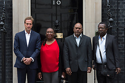 © London News Pictures. 22/05/15. London, UK. From L to R: TV presenter and adventurer Ben Fogle is joined by Sabrina Jean, Gianny Augustin and Clifford Volfrin, exiles of the Chagos Islands, to hand in a petition at 10 Downing Street calling for the islanders to be allowed to resettle on the islands, Westminster, Central London. Photo credit: Laura Lean/LNP