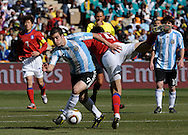 Argentina's forward Gonzalo Higuain (2nd-L) vies for the ball with defender Lee Jung Soo of Korea Republic during the World Cup South Africa 2010 soccer match, at Soccer City stadium, in Johannesburgo, South Africa, on June 17, 2010.  (Alejandro Pagni/PHOTOXPHOTO)