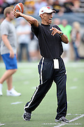 Former NFL head coach Tony Dungy throws a football on the field before the Pittsburgh Steelers 2015 NFL Pro Football Hall of Fame preseason football game against the Minnesota Vikings on Sunday, Aug. 9, 2015 in Canton, Ohio. The Vikings won the game 14-3. (©Paul Anthony Spinelli)