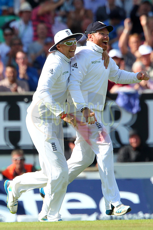 Ian Bell of England celebrates the wicket of Ravichandran Ashwin of India with Joe Root of England during day three of the fifth Investec Test Match between England and India held at The Kia Oval cricket ground in London, England on the 17th August 2014<br /> <br /> Photo by Ron Gaunt / SPORTZPICS/ BCCI