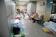 ZHENGZHOU, CHINA - (CHINA OUT) <br /> <br /> A Visit To The First Affiliated Hospital Of Zhengzhou University<br /> <br /> Relatives of patients have a rest in a corridor at The First Affiliated Hospital of Zhengzhou University on July 3, 2015 in Zhengzhou, Henan Province of China. According to the official data, The First Affiliated Hospital of Zhengzhou University has more than 7,000 beds, and more than 310,000 patients were hospitalized in the hospital last year, with the income of 7.5 billion yuan (1.2 billion USD). <br /> ©Exclusivepix Media