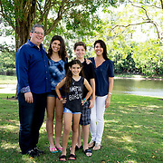 MAY 23, 2015---BOCA RATON, FLORIDA----<br /> The Zietz family in the backyard of their Boca Raton house. From left; Sam, Rachel,14, Morgan, 9, Jordan, 13, Rachel, 14, Morgan, 9 andSheila. Parents Sam and Rachel have instilled in their children the entrepreneurial spirit and it has paid off. Older children Rachel, 14, and her brother Jordan, 13, each has their own business and they're thriving.