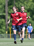 John O'Brien (l) leads Brian McBride (behind) in a fitness exercise on Wednesday, May 17th, 2006 at SAS Soccer Park in Cary, North Carolina. The United States Men's National Soccer Team held a training session as part of their preparations for the upcoming 2006 FIFA World Cup Finals being held in Germany.