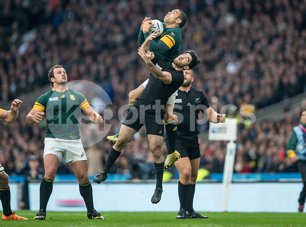 Brian Habana of South Africa collects the up and under from Nehe Milner-Skudder of New Zealand during the Rugby World Cup Semi Final match between South Africa and New Zealand played at Twickenham Stadium, London on the 24th of October 2015. Photo by Liam McAvoy