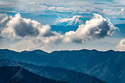 Mount Fuji = 12,388 ft, seen 100 miles to the southwest, from atop a trail accessible from the top of Chuzenjiko Skyline. Lake Chuzenji (Chuzenjiko) is a scenic lake in the mountains above the town of Nikko. It's at the foot of Mount Nantai, Nikko's sacred volcano, whose eruption blocked the valley below, thereby creating Lake Chuzenji 20,000 years ago. Chuzenjiko's shores are mostly undeveloped and forested except at the eastern end where the growing hot spring town of Chuzenjiko Onsen was built. Chuzenjiko is especially beautiful in mid to late October, when the autumn colors reach their peak along the lake's shores and surrounding mountains. See panoramic views of Lake Chuzenji along the Chuzenjiko Skyline, an eight kilometer long former toll road accessible by bus or car, which also connects to scenic hiking trails.
