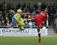 Photo: Lee Earle.<br /> Torquay United v Swindon Town. Coca Cola League 2. 18/11/2006. Torquay's Lee Thorpe (L) tries an overhead kick but is stopped by Jerel Ifil.
