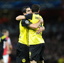 Borrusia Dortmund's Henrik Mkhitaryan celebrates with Borrusia Dortmund's Robert Lewandowski after scoring the opening goal of the game. - Photo mandatory by-line: Alex James/JMP - Tel: Mobile: 07966 386802 22/10/2013 - SPORT - FOOTBALL - Emirates Stadium - London - Arsenal v Borussia Dortmund - CHAMPIONS LEAGUE - GROUP F