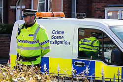 © Licensed to London News Pictures . 10/03/2014 . Farnworth , UK . Police and forensic scenes of crime examiners at a house on Kildare Street , Farnworth , where the body of 40 year old Marc Jepson was discovered on 5th March , as Greater Manchester Police announce that they have arrested two people as part of their murder enquiry . A 27 year old man and a 63 year old woman are in police custody for questioning . Photo credit : Joel Goodman/LNP