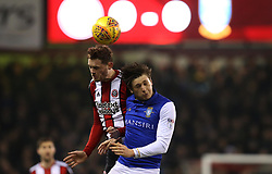 Jack O'Connell of Sheffield United beats Adam Reach of Sheffield Wednesday - Mandatory by-line: Robbie Stephenson/JMP - 12/01/2018 - FOOTBALL - Bramall Lane - Sheffield, England - Sheffield United v Sheffield Wednesday - Sky Bet Championship