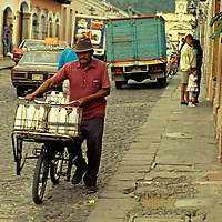 Central America, Guatemala, Antigua. The milkman making his rounds in Antigua, Guatemala.