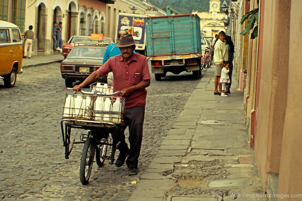 Central America, Guatemala, Antigua. The milkman making his rounds in Antigua, Guatemala.