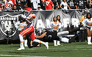 Sep 15, 2019; Oakland, CA, USA; Kansas City Chiefs wide receiver Demarcus Robinson (11) dragging  Oakland Raiders free safety Erik Harris (25) during the third quarter at Oakland-Alameda County Coliseum. The Chiefs defeated the Raiders 28-10..(Gerome Wright/Image of Sport)