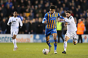 Shrewsbury Town's Josh Laurent and Wolverhampton Wanderers midfielder Joao Moutinho (28) during the The FA Cup fourth round match between Shrewsbury Town and Wolverhampton Wanderers at Greenhous Meadow, Shrewsbury, England on 26 January 2019.