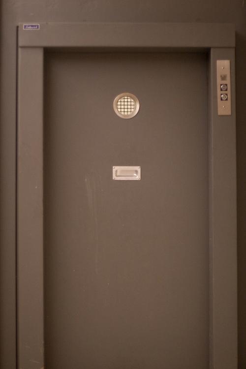 A grey modern steel door to an elevator.