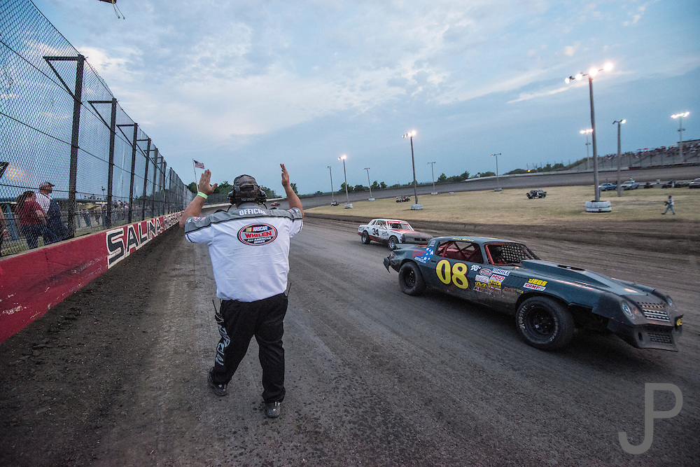 """Track official Jake Kelley from Glenpool, OK monitors the qualifying laps and acts as """"traffic cop"""" for racers entering and leaving the race track."""