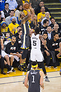 Golden State Warriors forward Andre Iguodala (9) shoots a three pointer against the San Antonio Spurs during Game 2 of the Western Conference Quarterfinals at Oracle Arena in Oakland, Calif., on April 16, 2018. (Stan Olszewski/Special to S.F. Examiner)