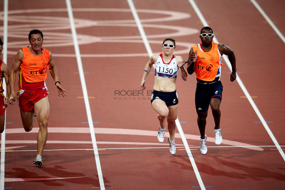 L - R Guohua Zhou and Guide Jie Li of China and Libby Clegg with guide Mikail Huggins of Great Britain in the women's 100 meter T 12 Final at the Olympic Stadium on day 4 of the London 2012 Paralympic Games. 2nd October 2012.