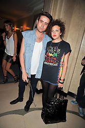 Television and radio presenter NICK GRIMSHAW and ANNIE MAC at a party hosted by Mulberry during London fashion Week 2009 at Claridge's Hotel, Brook Street, London on 20th September 2009.