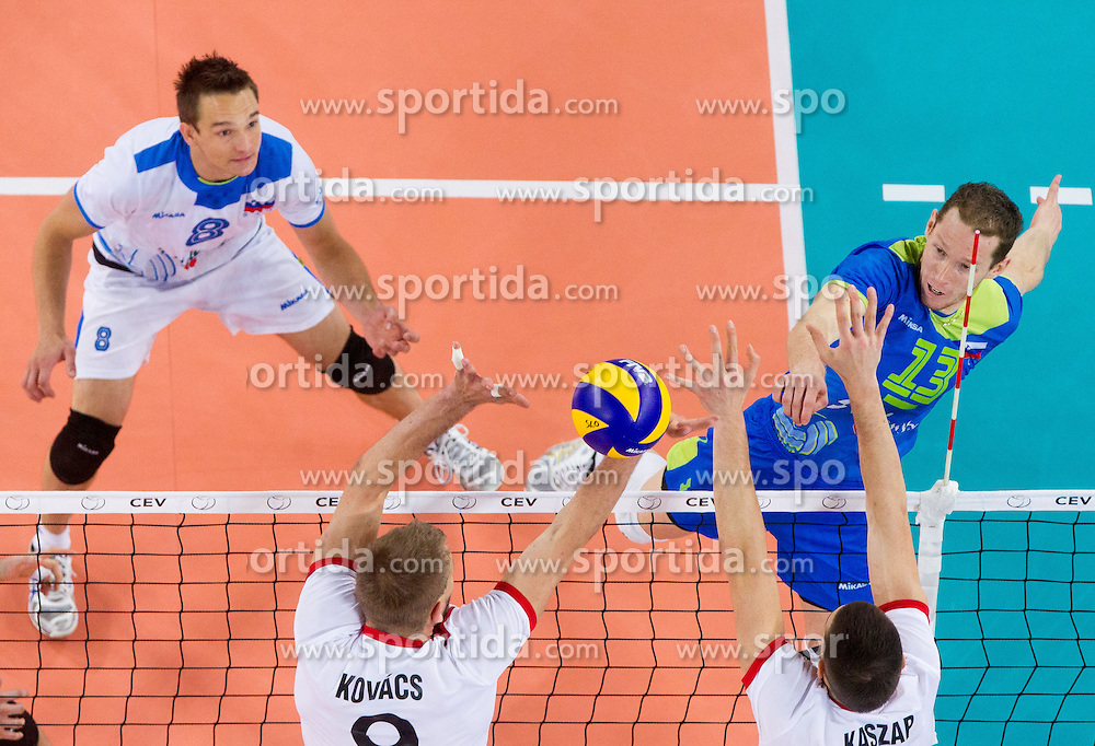 Tine Urnaut #13 of Slovenia vs Zoltan Kovacs and Tamas Kaszap of Hungary during qualifications match of FIVB Men's Volleyball World Championship 2014 between National teams of Slovenia and Hungary in pool B on May 25, 2013 in Arena Stozice, Ljubljana, Slovenia. Slovenia defeated Hungary 3-0. (Photo By Vid Ponikvar / Sportida)