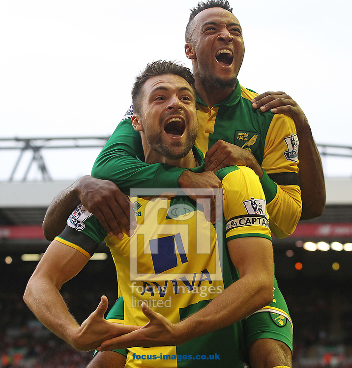 Soon to be new father, Russell Martin of Norwich celebrates scoring his sides equalising goal during the Barclays Premier League match at Anfield, Liverpool<br /> Picture by Paul Chesterton/Focus Images Ltd +44 7904 640267<br /> 20/09/2015